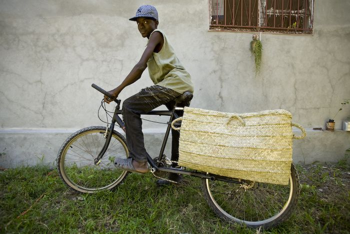 We just made a longtail cargo bicycle from a second-hand Ukrainian mountain bike. It was made in Haiti with a minimum amount of tools and measuring, but it rides well. This bike has carried three adults (400 pounds total) without catastrophic failure. It is currently being tested/abused by the teenager pictured.