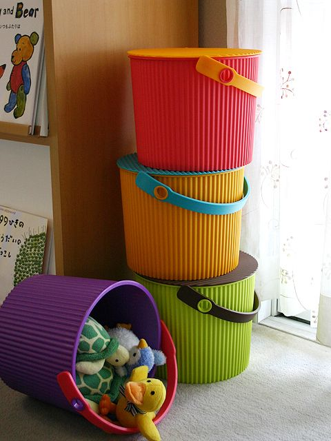 Omnioutil storage container for kids room, kitchen, garage. Any place where you want a pop of color and a place to sit. (It's a stool, too!)