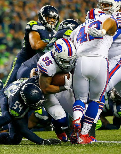 Running back Mike Gillislee of the Buffalo Bills scores a touchdown against the Seattle Seahawks at CenturyLink Field on November 7 2016 in Seattle...