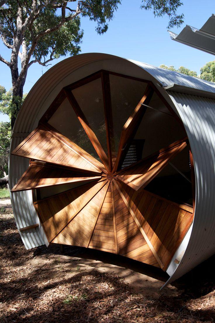 australian hardwood timber louvers cap the circular facade of the living pavilion