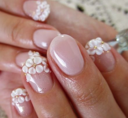 A beautiful French Manicure with Flowers Thought I liked it at first, but not so sure