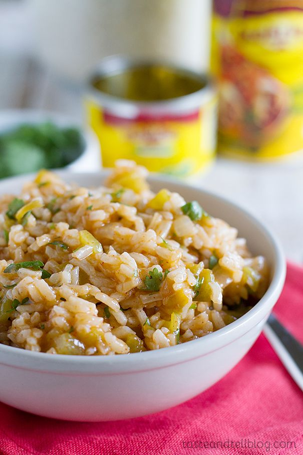 Enchilada Rice-With this Enchilada Rice recipe, you will get anything but dry, flavorless rice. And it's as easy as pouring a can of Old El Paso Enchilada sauce into cooked rice, add green chiles and some fresh cilantro.