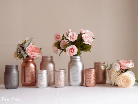***CURRENT TURNAROUND TIME IS 6 WEEKS**** These beautiful metallic painted mason jars are ideal for wedding centerpieces or home decor. They are painted on the outside only, so can hold fresh flowers and water. METALLIC PAINTED JARS MUST BE HANDLED WITH CARE. PLEASE TRY TO HOLD JAR FROM INSIDE RIM. This listing is for 3 quart size jars (6 3/4 tall), 2 pint size jars (5 tall) and 3 half pints jars (4 tall). Jars come with lids. The colors are classic rose gold, copper, pink rose gold…