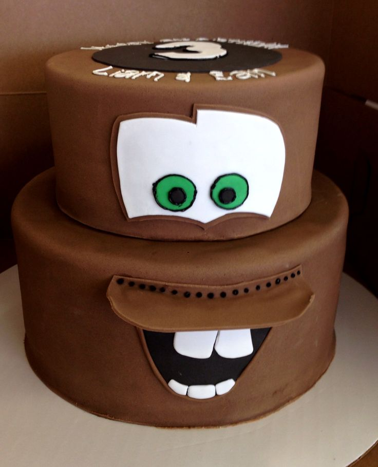 From the Disney Cars movies, Tow Mater two tiered stacked cake for a Disney inspired birthday party