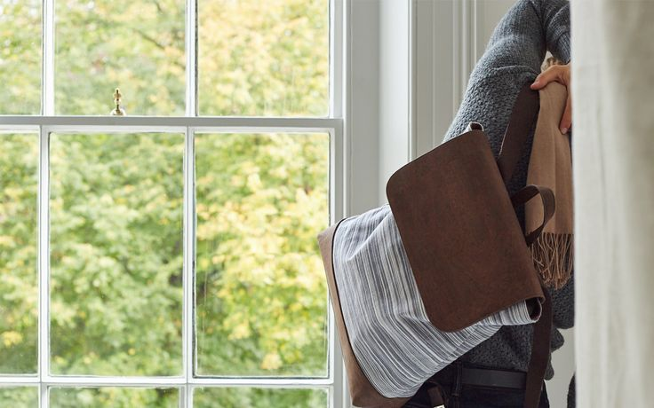 Awkward stretch by window with the Catherine Dang Oak backpack in grey Ikat fabric & cork textile.