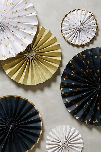 Create your own paper pinwheels from fun and festive printed paper. Use them to decorate your walls or table tops.
