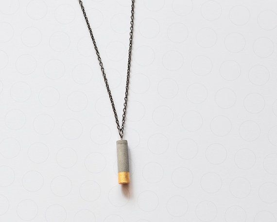 *concrete.pearls* minimalist concrete necklace, gold dipped cylinder Concrete is a special material with character, which allows any shape and