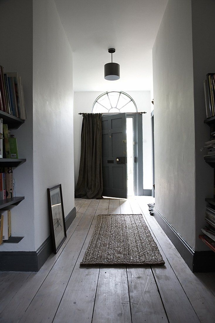 grey skirting boards with white walls creating a stylish hallway