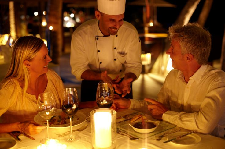 Make dinner reservations at a fancy restaurant and make sure to order a bottle of wine and dessert!