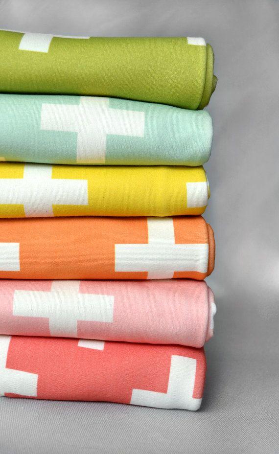 bright pastels, cross blankets