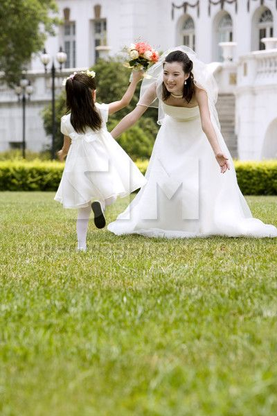 Young Chinese flower girl with the bride after a w