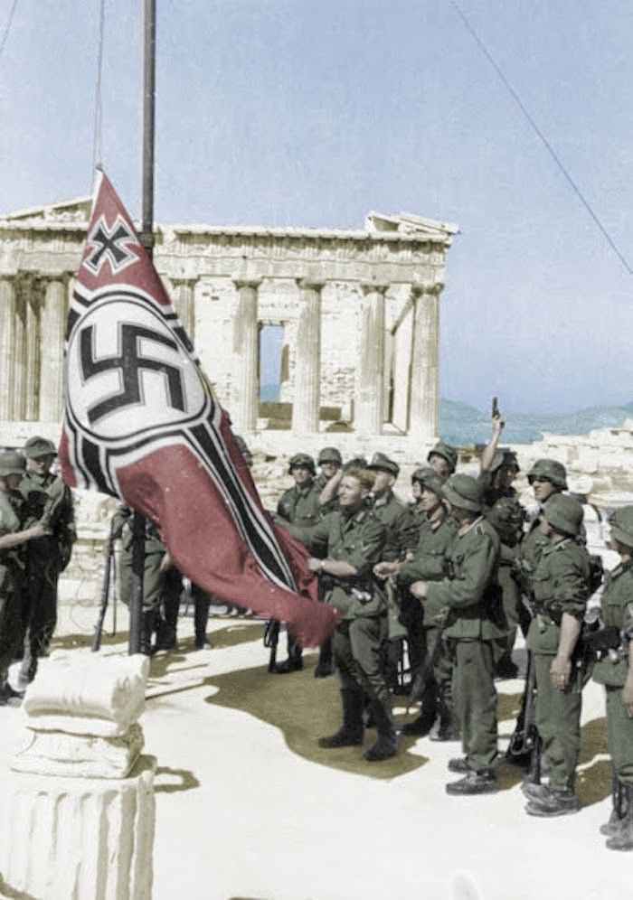 German soldiers raise their flag over the Acropolis in Athens, Greece Note the soldier on the right background apparently firing his pistol in celebration. - Never again