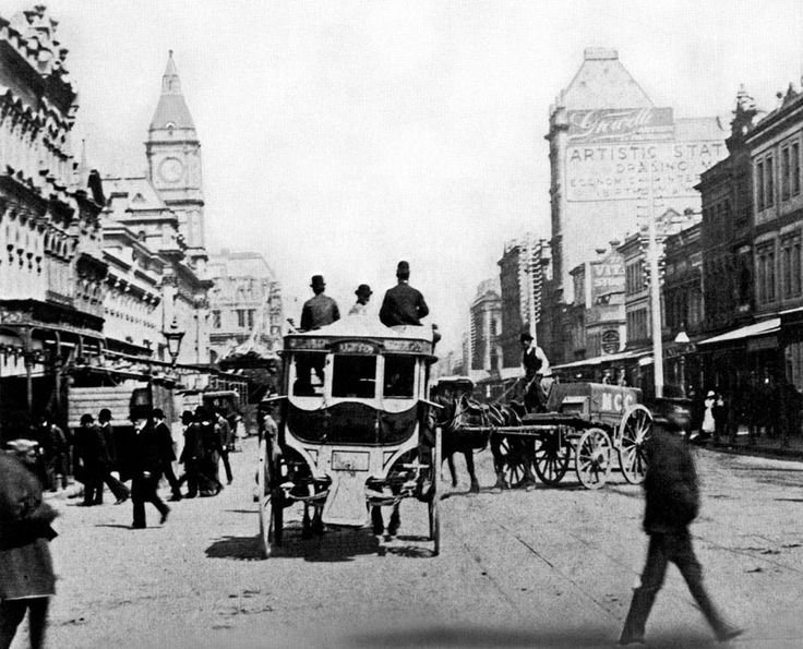 Swanston Street Melbourne Australia in the 1890s.  Notice the MCC water wagon spraying water in the middle of street to keep the dust down on the unsealed surfac...