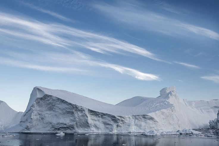 Landscape photograph of iceberg, sky and clouds in Greenland | Lawrence Hislop Photography.