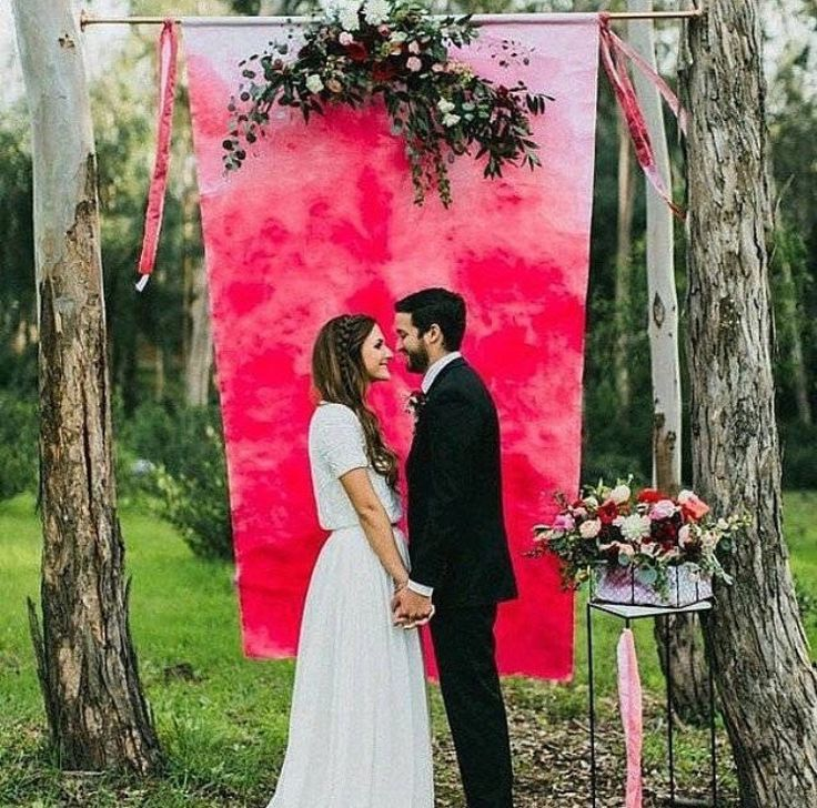 Watercolor backdrop for wedding ceremony