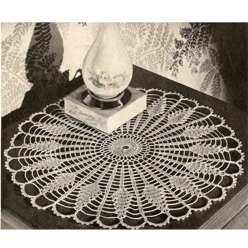 Crochet Sundial Pineapple Doily Pattern  This doily, medium in size at 13 inches, is a pineapple replica of a sundial.  It's a marvelous piece that not only will look great on a table, but splendid on a colored background and framed