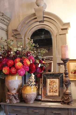 A little italian style.. the pottery, mirror and flowers are so pretty