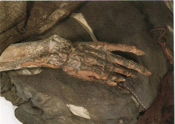 The Tarim mummies are a series of Europoid mummies which date from 1800 BCE to 200 CE. The mummies are associated with the presence of Indo-European Tocharian languages. Many have red or light brown hair, wear tartan, and have tattoos.