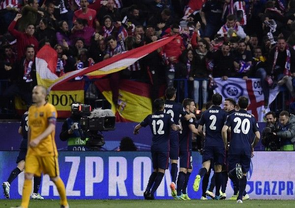 Atletico Madrid players celebrate after scoring a goal during the Champions League quarter-final second leg football match Atletico de Madrid vs FC Barcelona at Vicente Calderon stadium in Madrid on April 13, 2016.