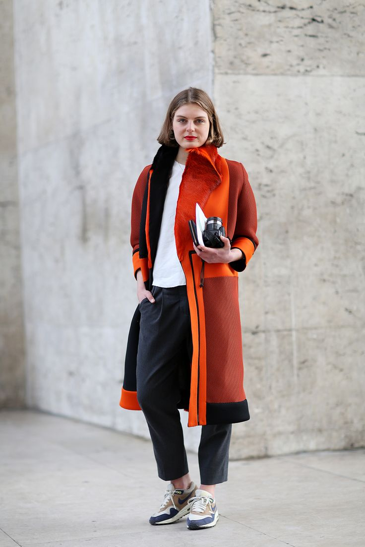 """ Sneakers were everywhere in Paris. We love the way they funk up this outfit of staple pieces and a statement coat. "" I must try this...:"