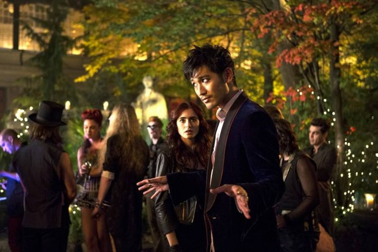 new stills from 'The Mortal Instruments: City of Bones' Clary Fray (Lily Collins) & Magnus Bane (Godfrey Gao)