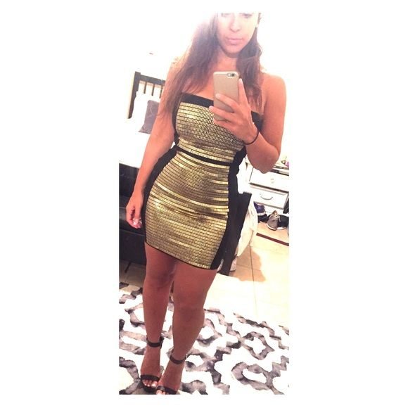 Black & gold bandage dress Perfect dress for vegas! All eyes will be on you! Bandage dress with gold pieces on dress. There are some missing gold pieces as shown in picture; when dress is on you don't notice it. WOW couture Dresses