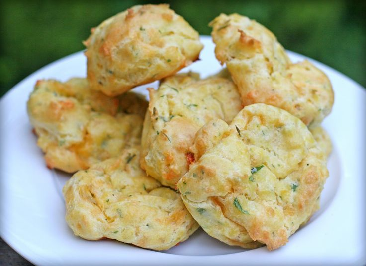Filled with a savory cheese and herb mixture, these puffy biscuits are simple, delicious and make a great party appetizer. I have mad...