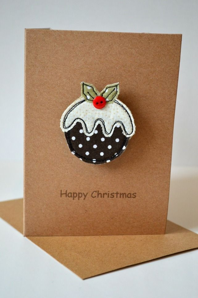 Christmas card with a Christmas pudding fabric brooch attached. £8.00