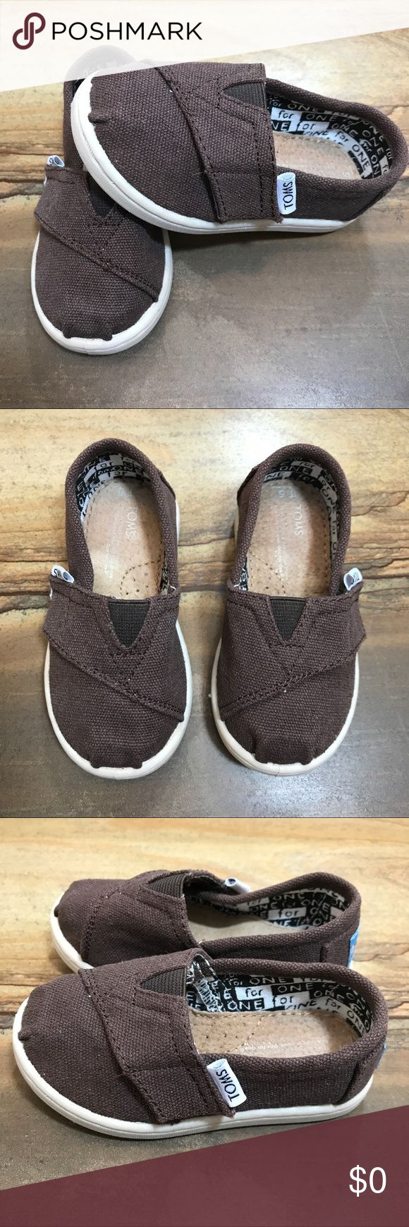 Tiny TOMS Dark Brown sz 4 Tiny TOMS. Dark brown. Size T4 for a toddler.  Brand new and never worn, but no tags or box. TOMS Shoes Baby & Walker