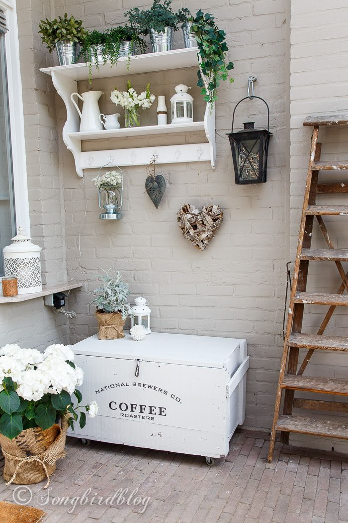 Outdoor decorating on the terrace with an old army crate makeover with Fusion paint and Old Signs Stencils, burlap pots, and lots of white flowers.