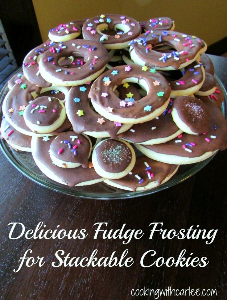 This fudgy frosting is perfect for spreading over cookies for a chocolaty delicious finish that is stackable. Your cookie trays just got an upgrade! #frosting #chocolate #cookies #recipes