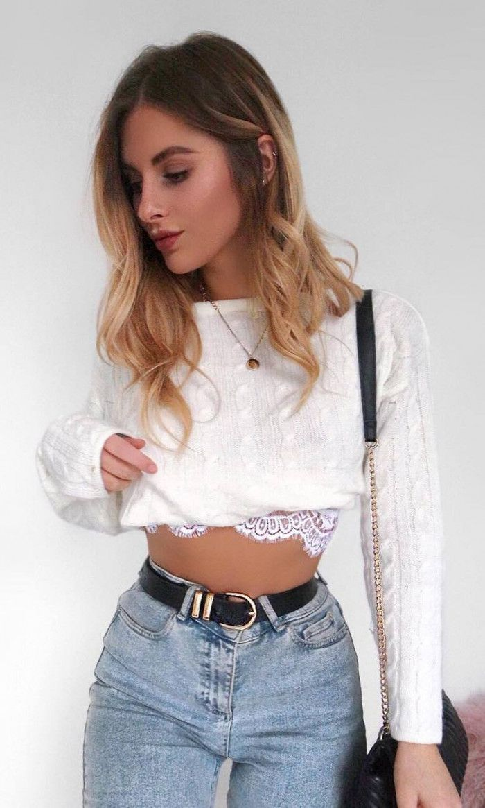 8718ef5220b7 spring outfit inspiration   white crop sweater bag high weist jeans