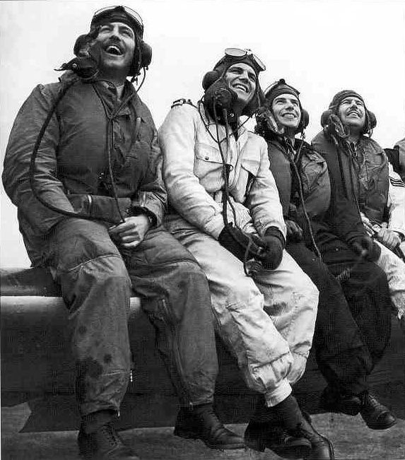 """S/L Kenneth BB """"Bing"""" Cross (left) sits on the wing of Hurricane Mk I LK-O with pilots of No 46 Squadron RAF at RAF Digby on 2 November 1939, following a visit of King George VI to the station. While the royal inspection was still underway, the pilots were ordered to its forward base at RAF North Coates, from which they returned the same evening, with the exception of Red Section. The aircraft from No 87 Squadron RAF was collected by a pilot from the Ferry Pool and flown for service in…"""