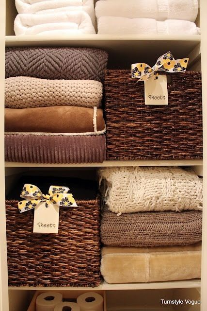 Linene closet organization: Alternate baskets and stacked towels/linens to avoid messy piles falling into one another.