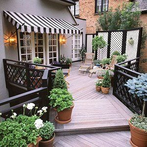 Simple solutions with a big impact: Awnings, lattice screens, lanterns for lighting, ikea folding chairs, potted plants. (Thanks @Holly Mathis)