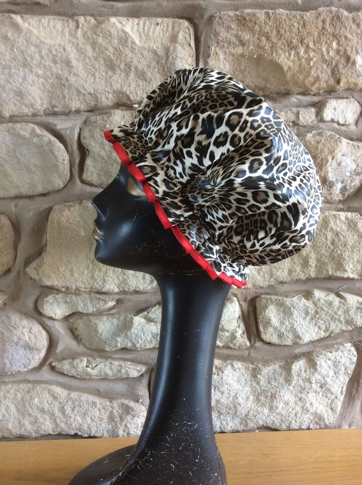 Wild Leopard shower cap with a red trim to match the gorgeous red lining......  find the BathingBellesStore on Etsy