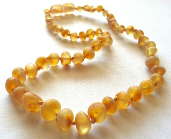 Baltic amber teething necklaces from Lithuania contain succinic acid, a natural pain reliever, which is released when the amber is warmed by the skin. If you're little one is having a rough time with teething, a baltic amber necklace is a must-have!