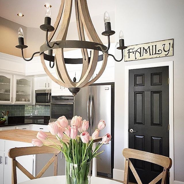 Kelli's #kitchen is so warm and inviting! I Spy our Wine Barrel Chandelier above her table! #lighting