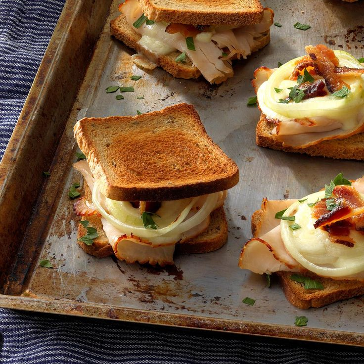 Mini Hot Browns Recipe -Here's my take on the famous Hot Brown sandwich. Guests quickly saddle up for juicy turkey slices and crispy bacon, piled on toasted rye bread and then topped with a rich cheese sauce. —Annette Grahl, Midway, Kentucky