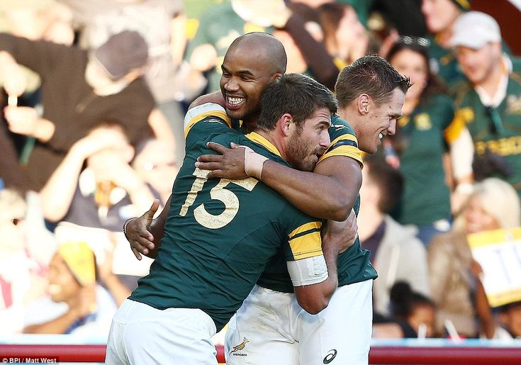 Winger Pietersen celebrates his breakthrough try withWillie le Roux as Samoa were put to the sword by the Springboks in the Midlands