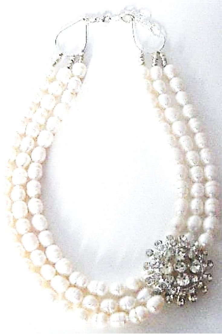 White freshwater pearls & Vintage Rhinestone brooch necklace.  One-of-a-kind statement necklace handmade with white freshwater pearls paired with vintage brooch $275,00. #statementnecklaces#necklaces#freshwaterpearl#handmadenecklace