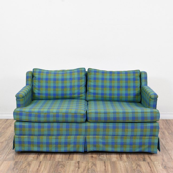 This sofa is upholstered in durable plaid print fabric with dark blue, light blue and green accents. This loveseat sofa is in good condition with a low back, stuffed cushions and a pleated skirt. Comfortable couch perfect for lounging in front of a tv! #traditional #sofas #sofaorcouch #sandiegovintage #vintagefurniture