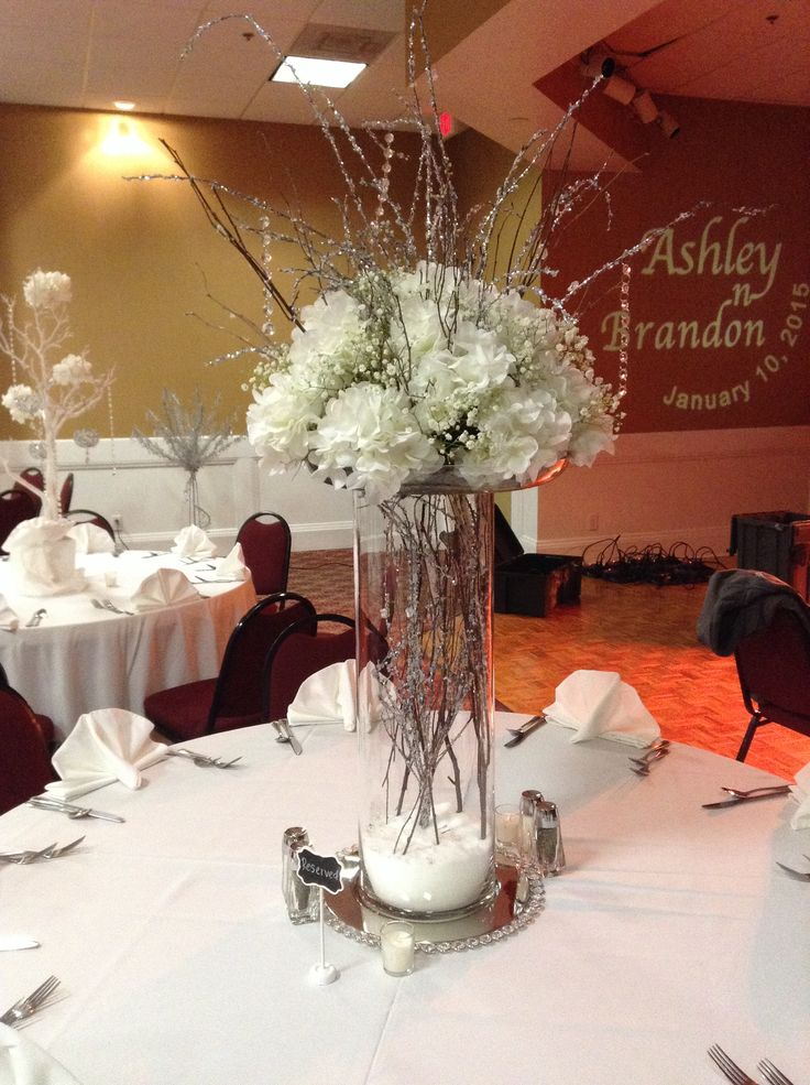 Glass cylinder vases with white hydrangea baby 39 s breath for Glass wedding centerpieces