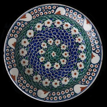 Plate        Place of origin:        Iznik, Turkey (made)      Date:        second half of 16th century (made)      Artist/Maker:        Unknown (production)      Materials and Techniques:        Fritware, polychrome underglaze painted, glazed