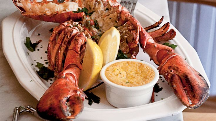 Split Grilled Lobsters with Herb Butter | From comfort food (Lobster Mac and Cheese!) to classic (Lobster Rolls!), these are our very favorite ways to serve this delectable crustacean.