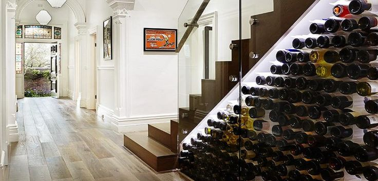 From wine racks to secret storage closets, a collection of design ideas for the unused space under your stairs.