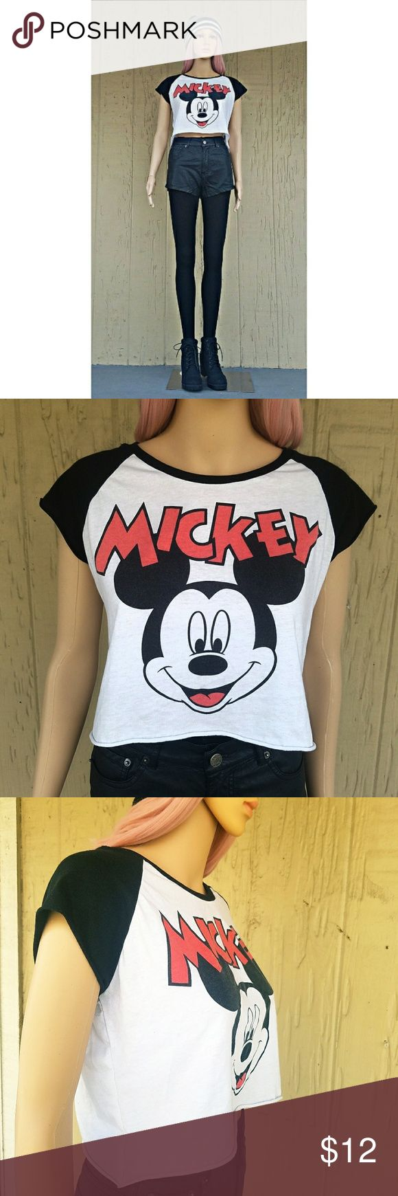 "Disney White And Black Mickey Mouse Crop Top Disney Mickey Mouse black panel cap sleeves crop top featuring the little guy's mug himself in blacl and white. A red tongue and classic red lettering that reads ""Mickey"" adds major pop to this top.  60% Cotton 40% Polyester  Color(s): White, Black, Red Disney Tops Crop Tops"