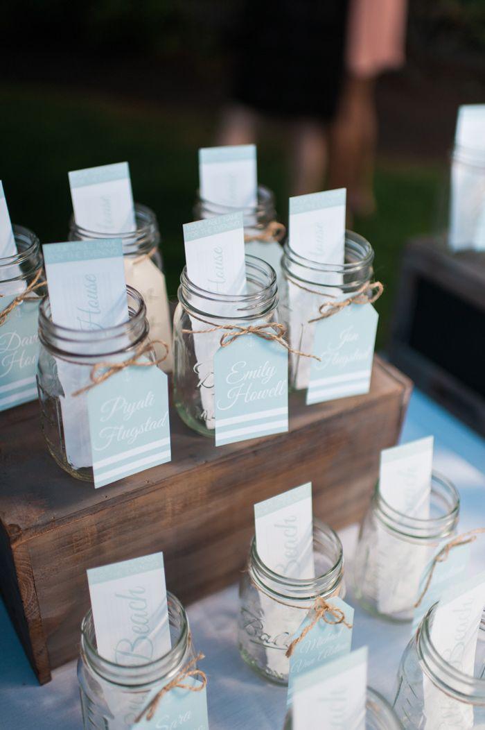 mason jar escort cards // photo by Carina Skrobecki // view more: http://ruffledblog.com/pacific-northwest-beach-wedding