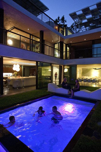Pool in u-shaped courtyard bringing the outdoors in.