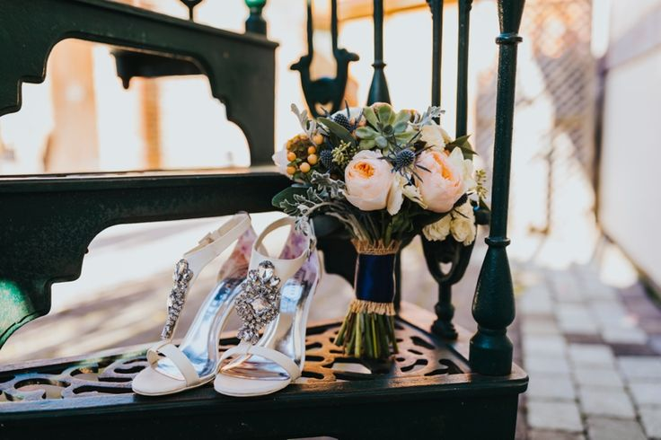 Statement shoes that can be work again are a big win. Plus how beautiful are those thistles in this bridal bouquet? Photo by Benjamin Stuart Photography #weddingphotography #weddingshoes #highheels #bridalbouquet #bling #weddingday #bride